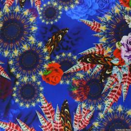 Tissu Satin de soie imprimé bucolique plume fond bleu x10cm
